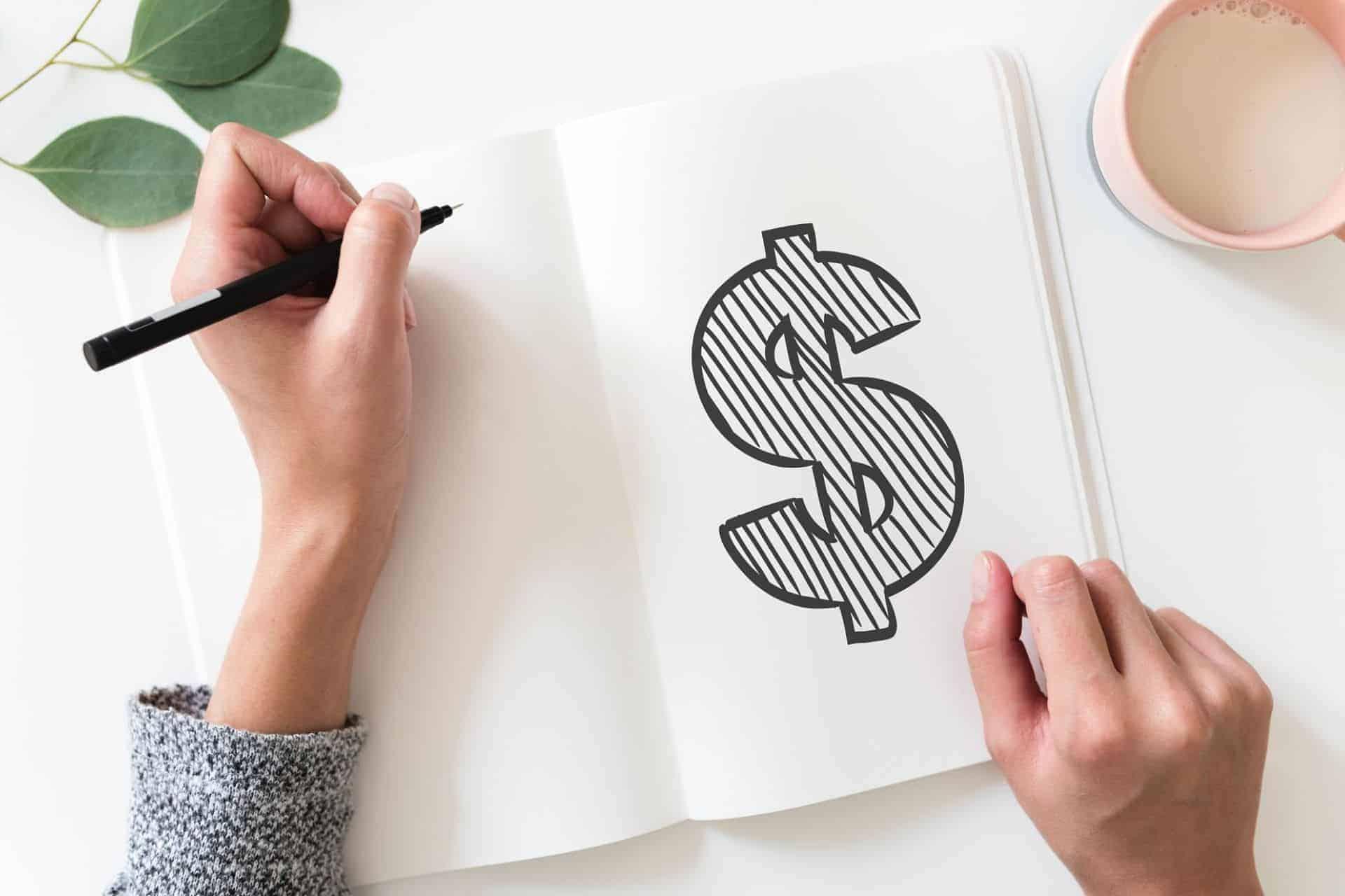dollar sign in journal on desk